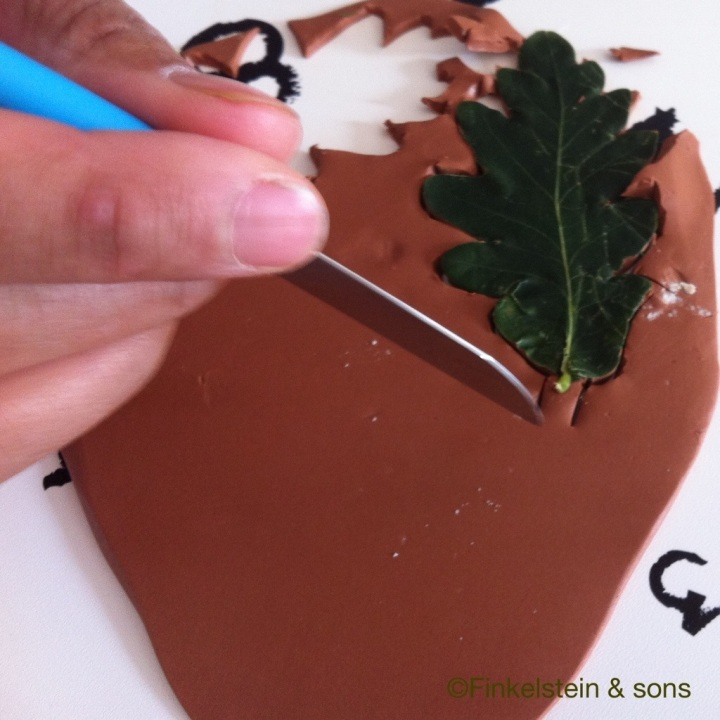 Cutting out an oak leaf shape for a Ranger's Apprentice pendant