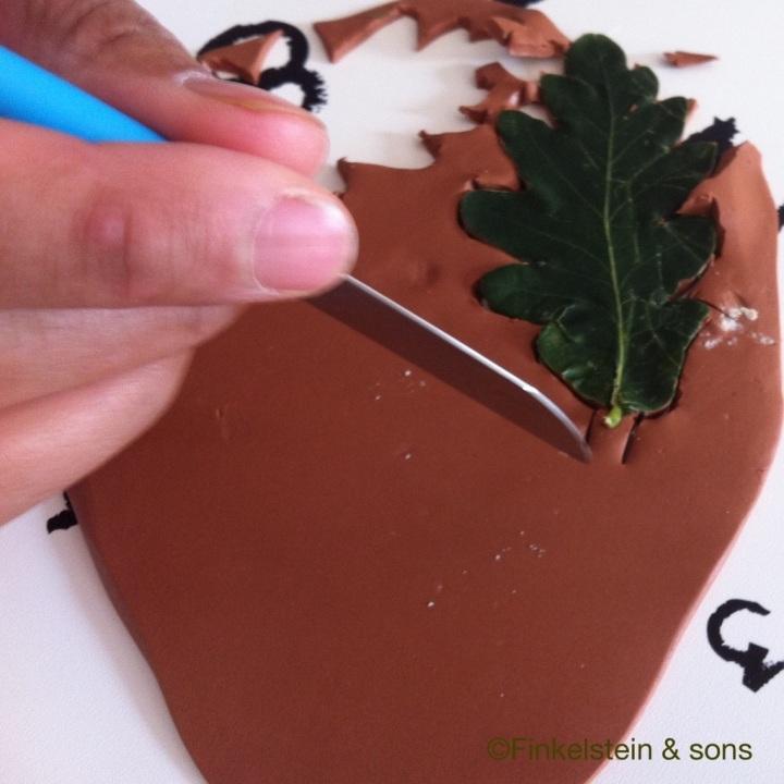 Cutting out an oak leaf shape for a Ranger's Apprentice pendant
