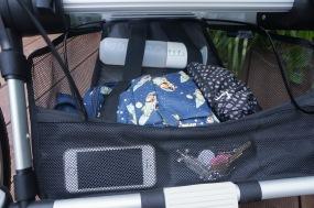 In het bagagevak kun je handig je hardloop accessoires kwijt. En je luiertas.