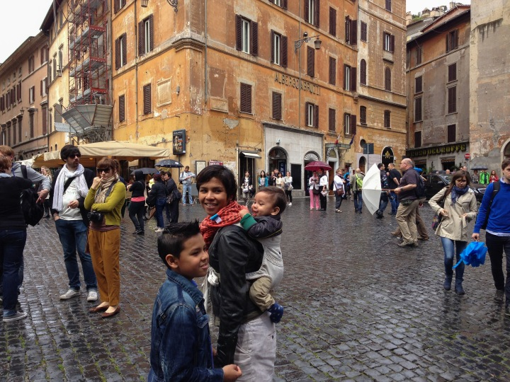 Mom with baby carrier in Roman square