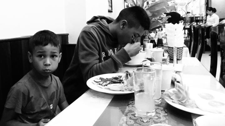 Kids having breakfast in Hanoi