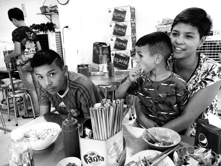 family Eating bun cha in Hanoi